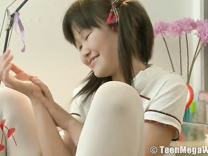 Petite Asian Teen In Pigtails Dresses Like A Schoolgirl