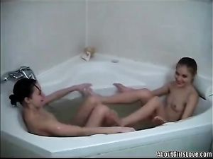 Young Lesbian Couple Fools Around In The Bathtub